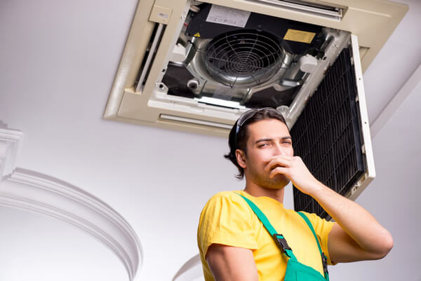 central air conditioner smells like chemicals